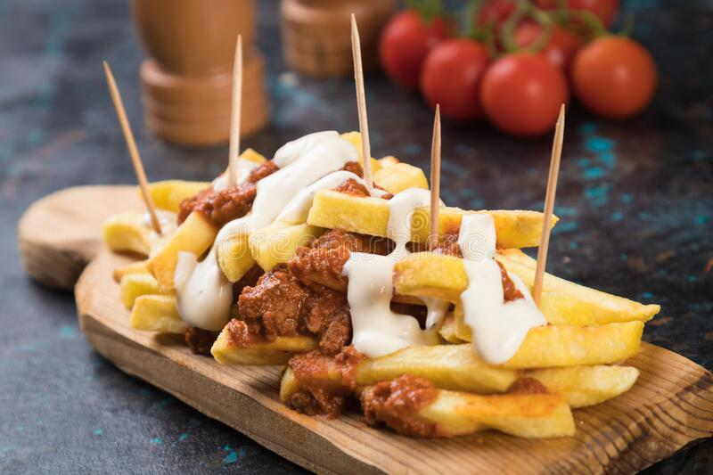 French fries with minced meat salsa stock photos