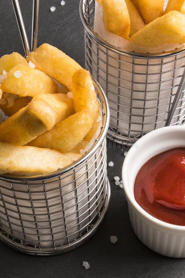 French fries in a serving basket, served with home made ketchup stock photos