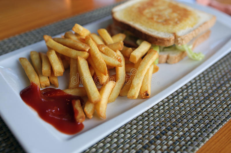 French fries and vegetable sandwich stock photography