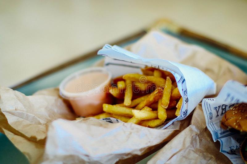 French Fries on White Paper stock photography