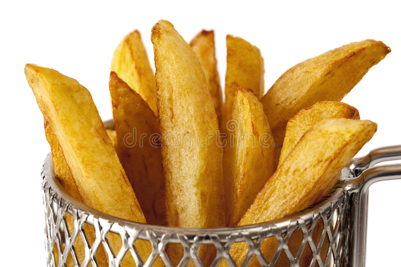 French Fries in Wire Basket. French fries or potato chips in a small wire frying basket, over white background stock photography