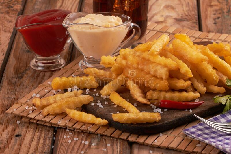French fries on wooden table royalty free stock photography