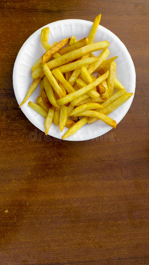 French Fries on a Wooden Table. Top View of French Fries on a Wooden Table stock image