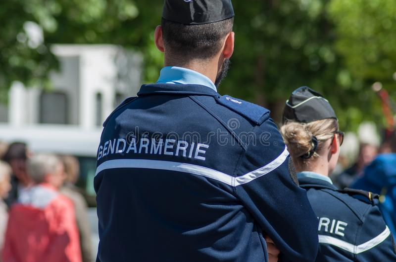 French gendarmerie patrol in lily of the valley party in the street. Brisach - France - 1 May 2018 - french gendarmerie patrol in lily of the valley party in the royalty free stock photography
