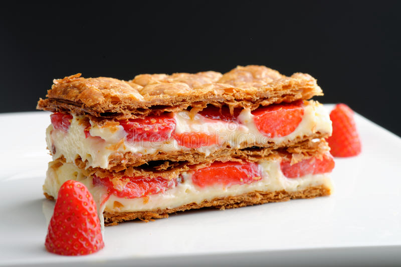 French gourmet strawberry mille feuille. With whipped sour cream. Shallow dof royalty free stock images