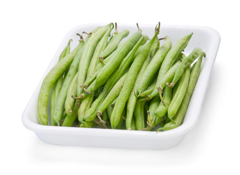 French green bean. French bean in plastic box isolated on white royalty free stock image