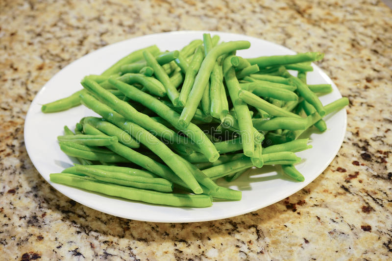 French green bean. In a white plate royalty free stock images