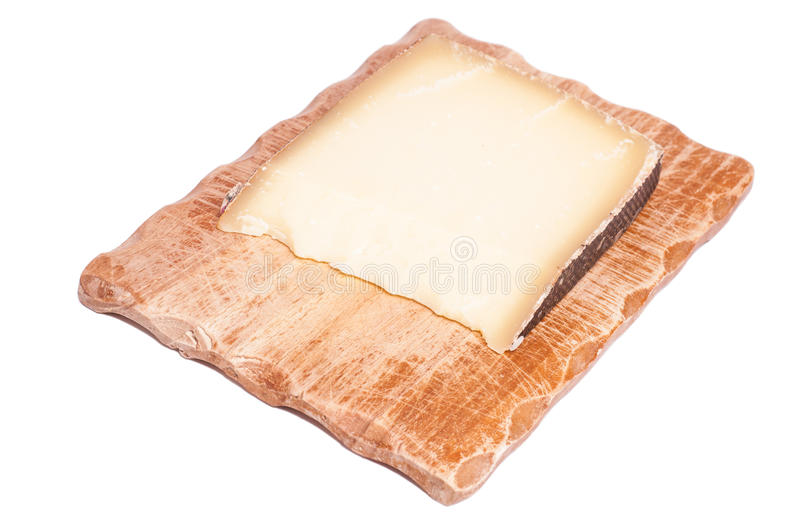 French gruyere cheese. On a wooden board royalty free stock image