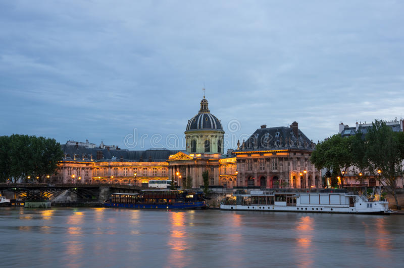 The French Institute and the Seine river at night royalty free stock photography