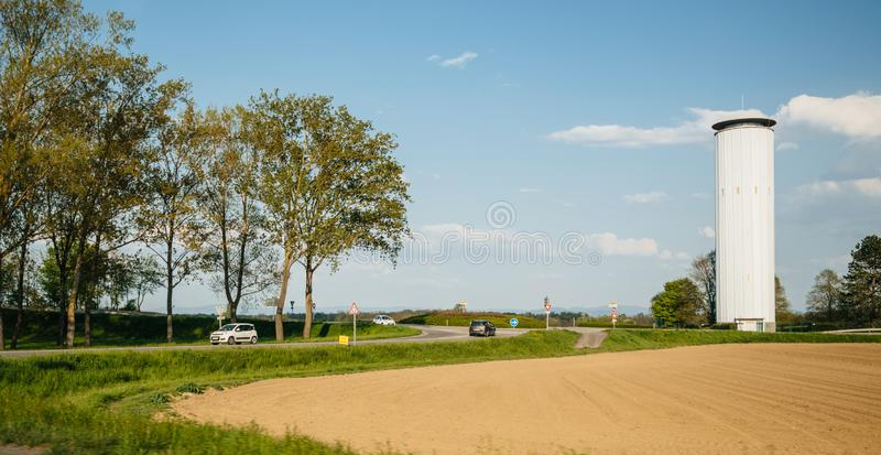 French intersection with cars and big water tower stock images