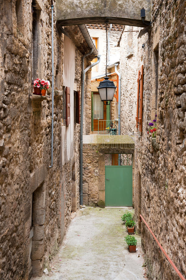 French lane. Little French romantic lane with floers and lantern stock photo