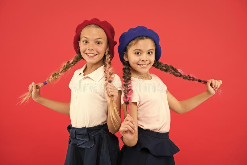 French language school. School fashion concept. Pupil smiling girls wear formal uniform and beret hats. International stock photos
