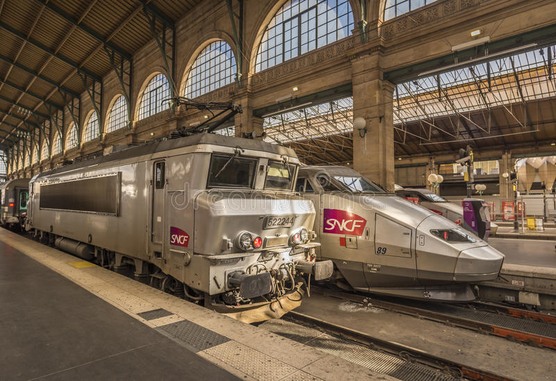 French locomotives parked in main Paris train station. Paris, France - February 15, 2016: Two different type of SNCF locomotives parked in Gare du Nord, Paris stock images