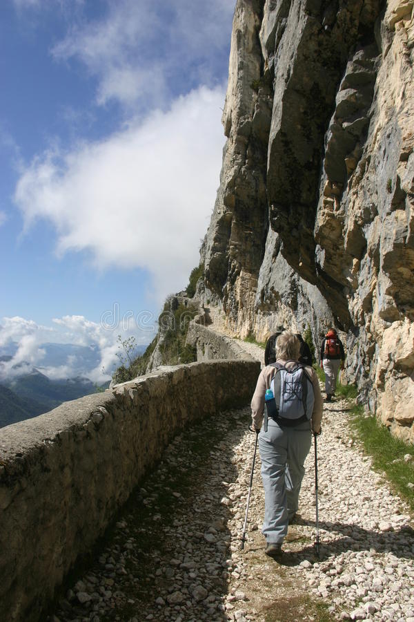 French alpine path with walkers royalty free stock photo