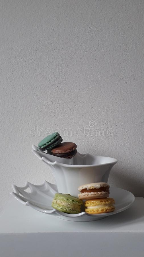 Mix macarons served in cup stock images