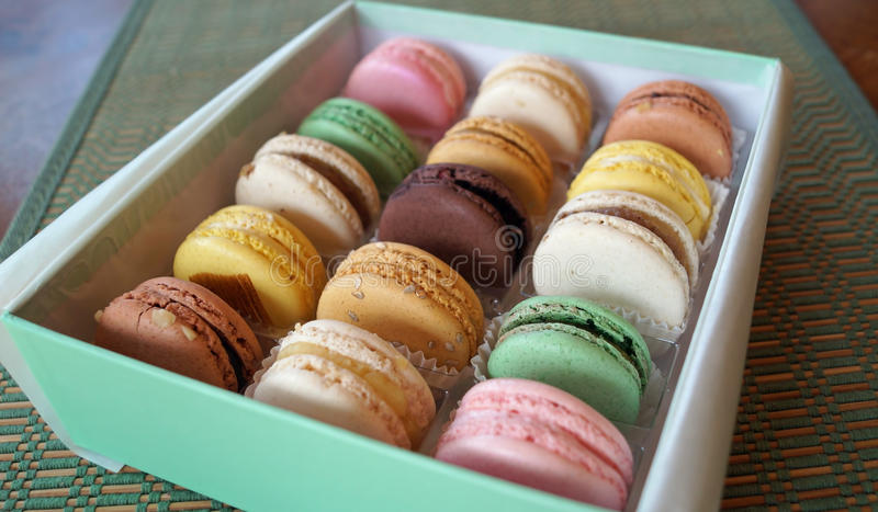 French Macarons. A gift box of colorful French macarons in assorted flavors royalty free stock photos