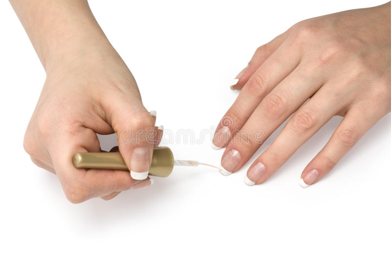 French manicure. Manicurist applying french manicure on female fingers stock photos