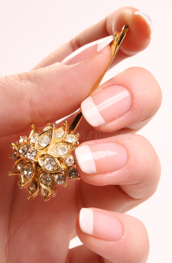 French manicure and a hairpin stock photography