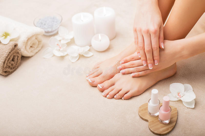 French manicure and pedicure. In spa royalty free stock photography