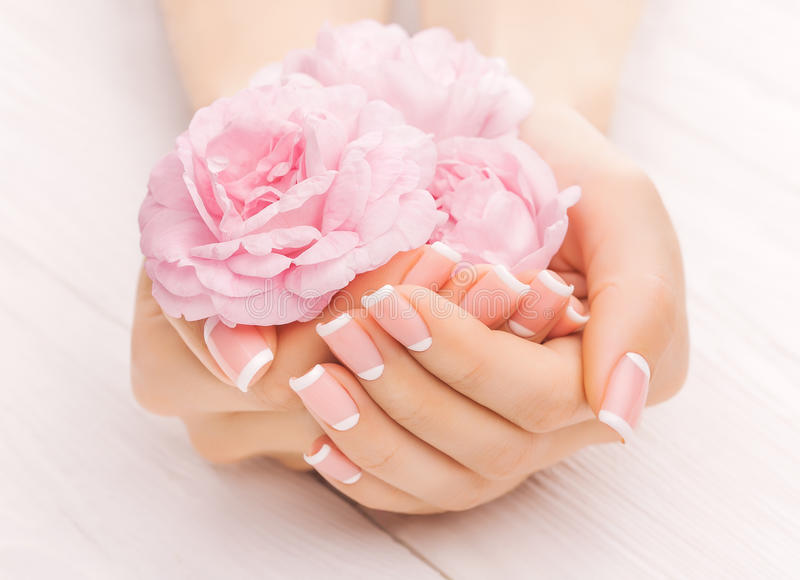 French manicure with rose flowers. spa stock photos