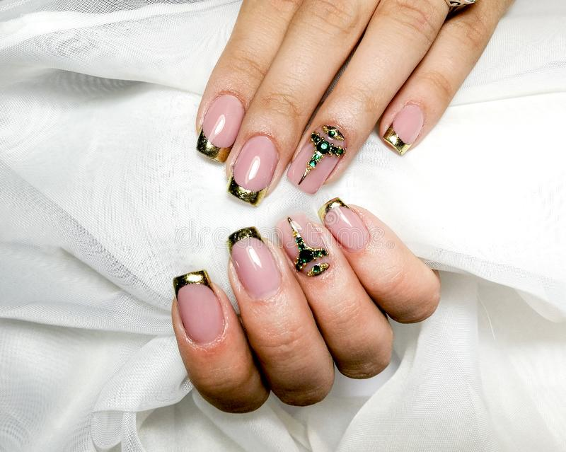 French manicure  on white textile fabric royalty free stock photos