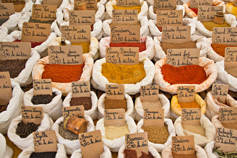 French Market Spices in bags. Colorful assortment of generic fresh market spices in cotton bags with handwritten French signs royalty free stock photo