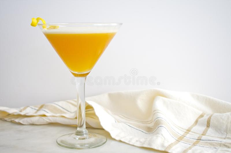 French Martini Garnished with a Lemon Twist stock photography
