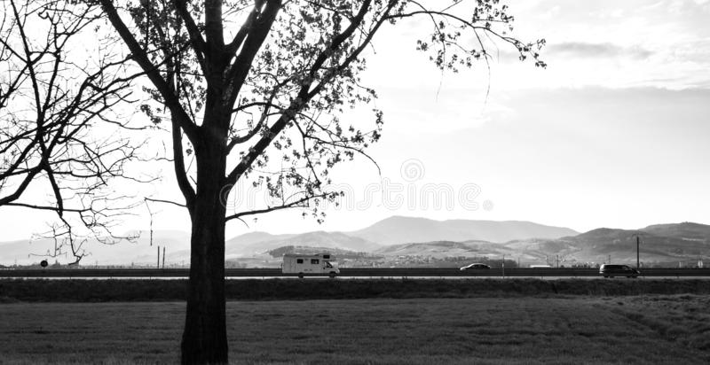 French mountains silhouettes and cars trucks driving fast royalty free stock photography