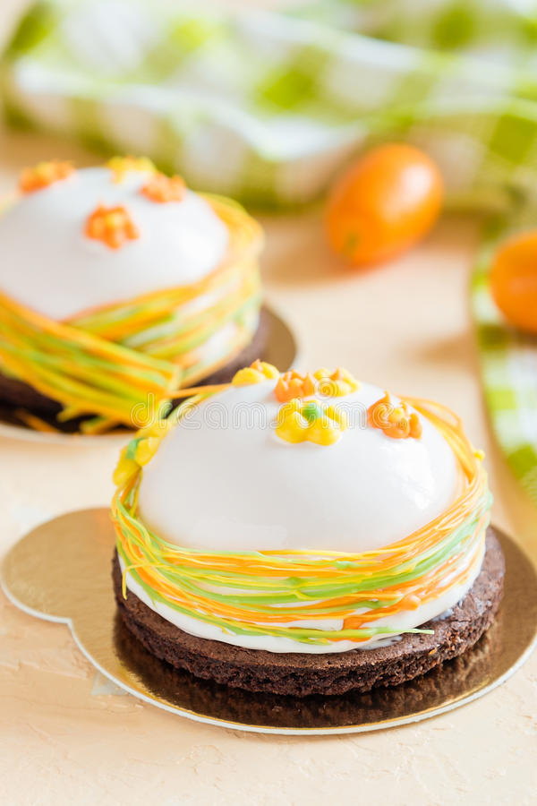 French Mousse Cakes With White Glaze And Easter Decoration