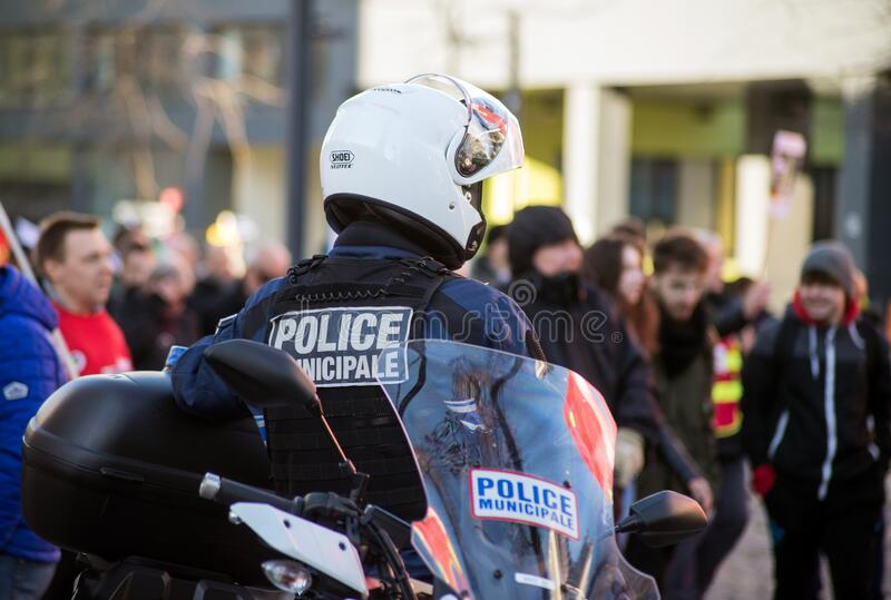 french municipal police on motorbike looking demonstration against pension reforms in the street royalty free stock image