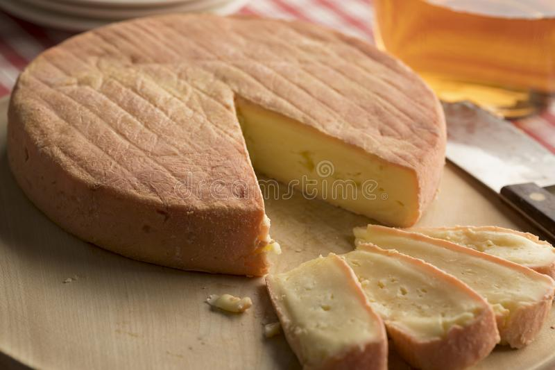 French Munster cheese and slices royalty free stock image