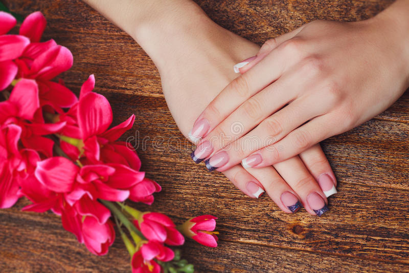 French nail art in purple color stock image
