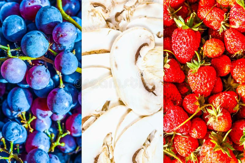 French Flag of France made with food. The French national flag of France, Europe made with food including grapes, mushrooms and strawberries royalty free stock photo