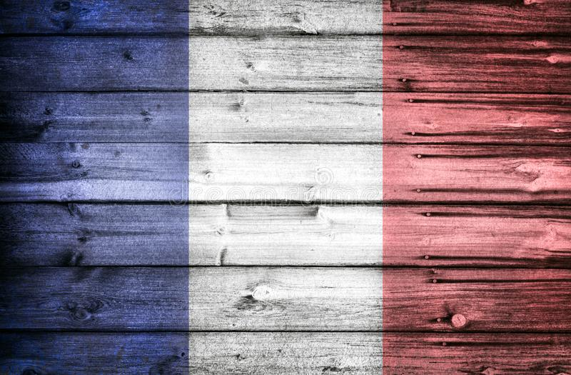 French national flag painted on wooden weathered rustic wall. National flag, country and patriotic concept. French revolution theme, liberte, egalite royalty free stock photo