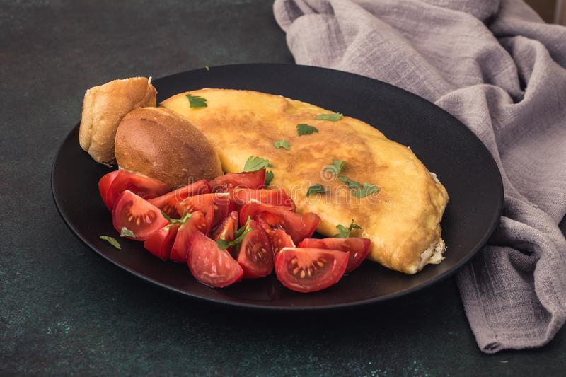 French omelet with tomatoes stock images