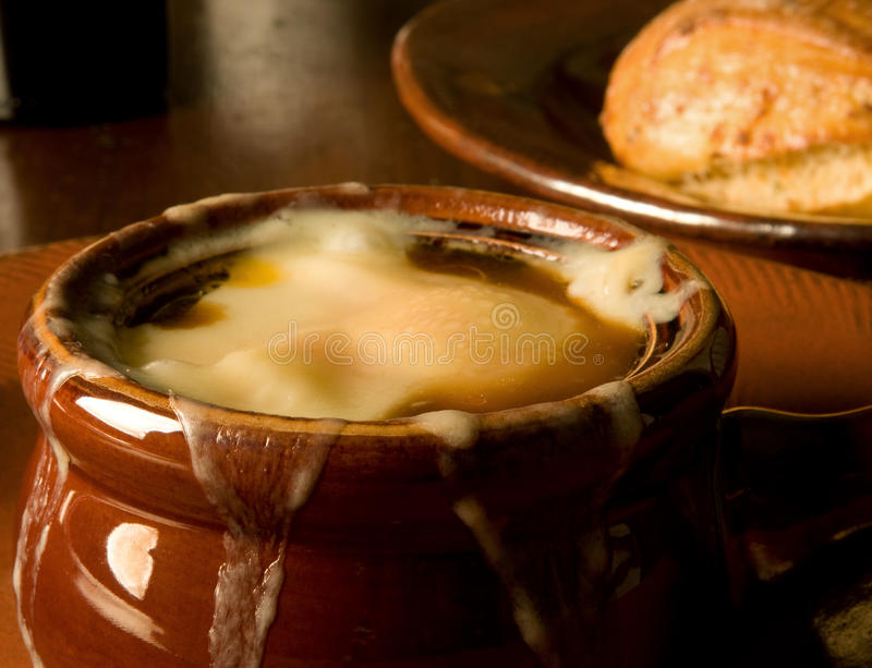 French onion soup. Close up of hot French onion soup, loaded with melted Gruyere stock photo