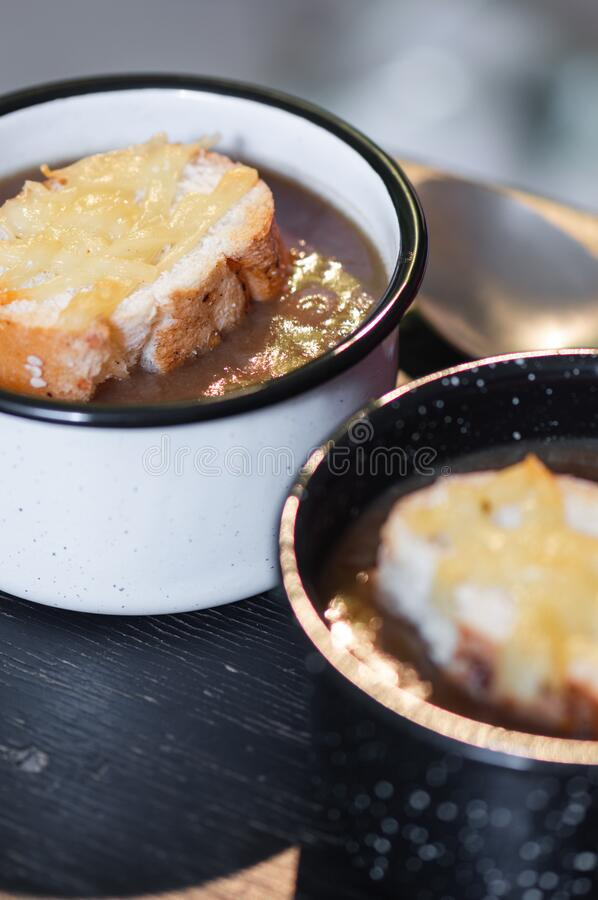 French onion soup with cheese topped croutes stock photo