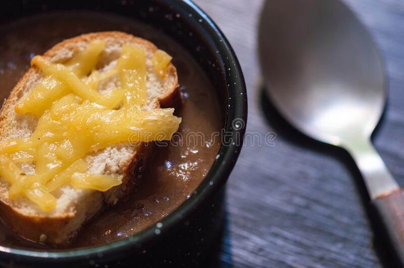 French onion soup with cheese topped croutes stock image