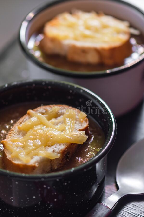 French onion soup with cheese topped croutes stock photography