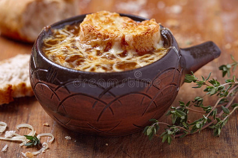 French onion soup. On rustic wooden table royalty free stock photos