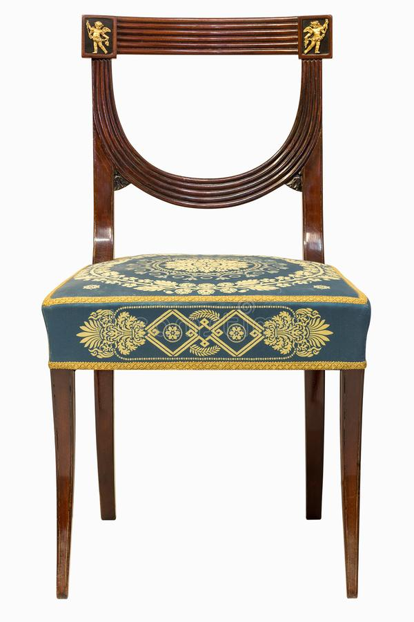 French Ormolu Mounted Empire Style chair. 19th French Ormolu Mounted Empire Style chair isolated on white background royalty free stock photography