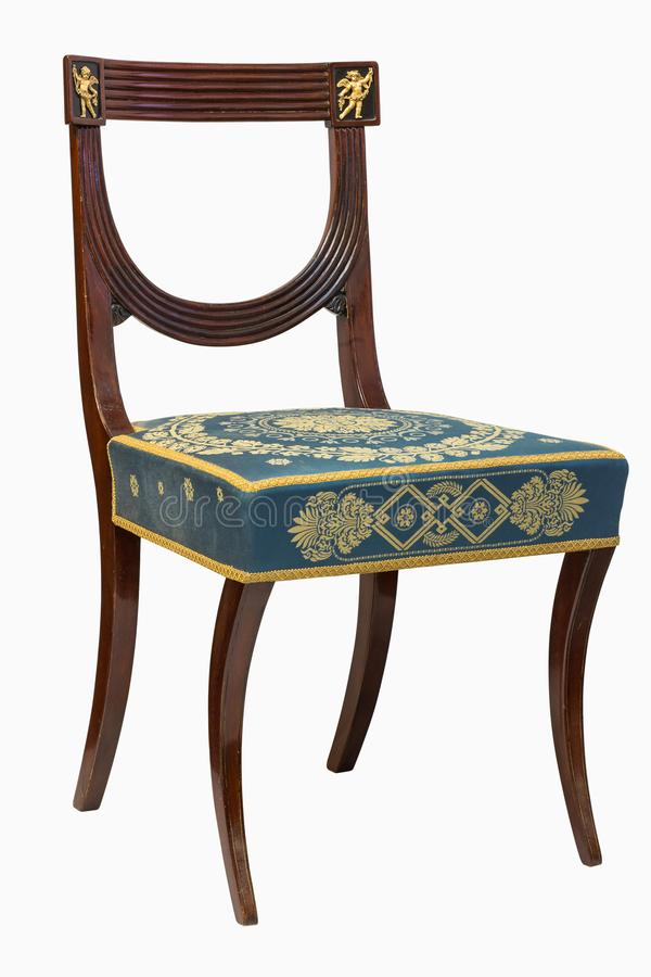 French Ormolu Mounted Empire Style chair. 19th French Ormolu Mounted Empire Style chair isolated on white background royalty free stock images