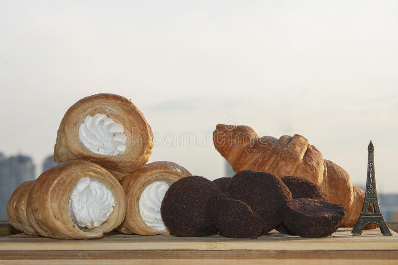 French pastries and sweets. French homemade pastries and sweets: croissant, tubes with cream, truffles stock photography