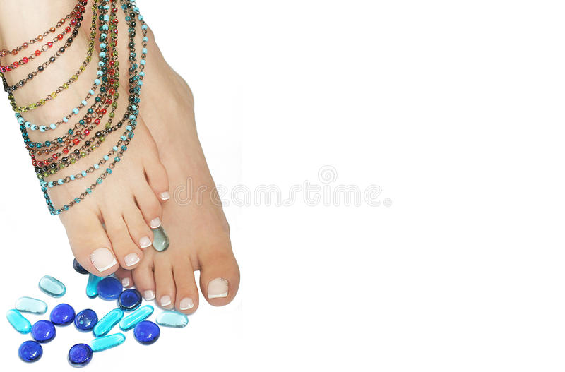 French pedicure. Beautiful young feet with French pedicure royalty free stock photography