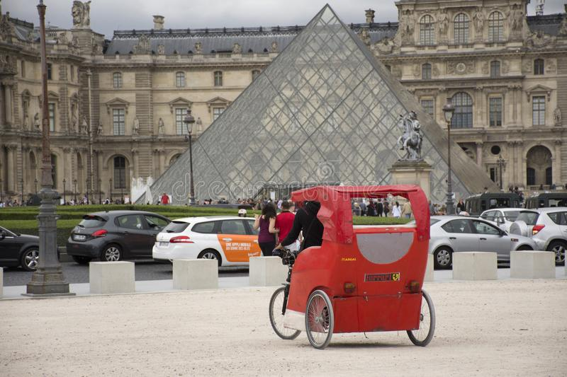 French people biking bicycle rickshaw waiting travelers use service tour around paris. At Musee du Louvre or the Grand Louvre Museum on September 5, 2017 in stock photos