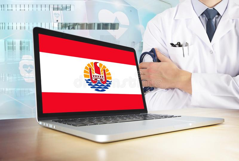 French Polynesia healthcare system in tech theme. Polynesian flag on computer screen. Doctor standing with stethoscope in hospital. Cryptocurrency and stock images