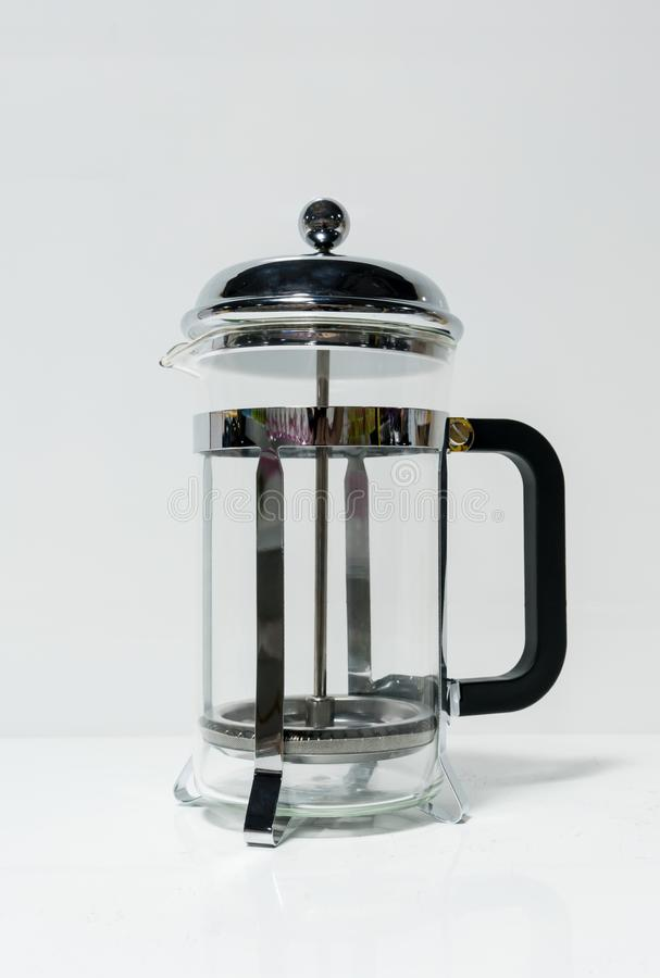 French press coffee maker with black handle on white stock image
