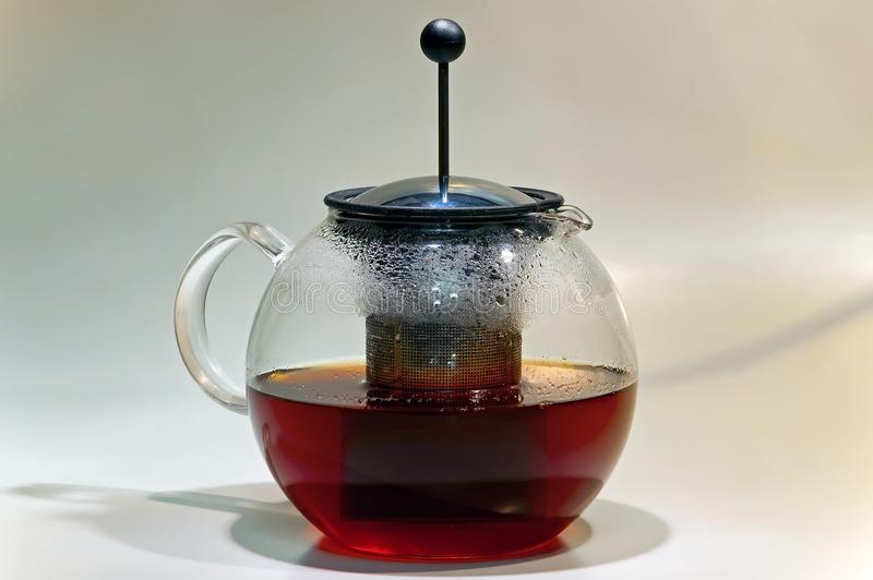 French press glass brewing teapot. With black tea royalty free stock photography