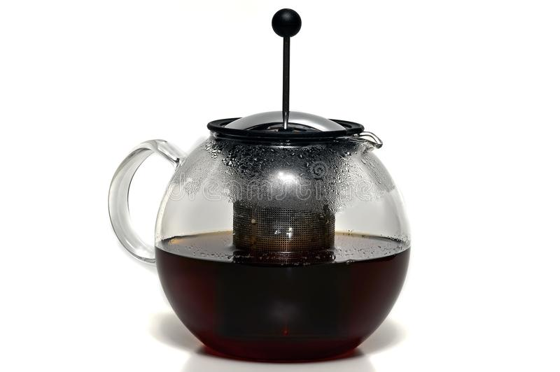 French press glass teapot. With tea brewing isolated on white background royalty free stock image