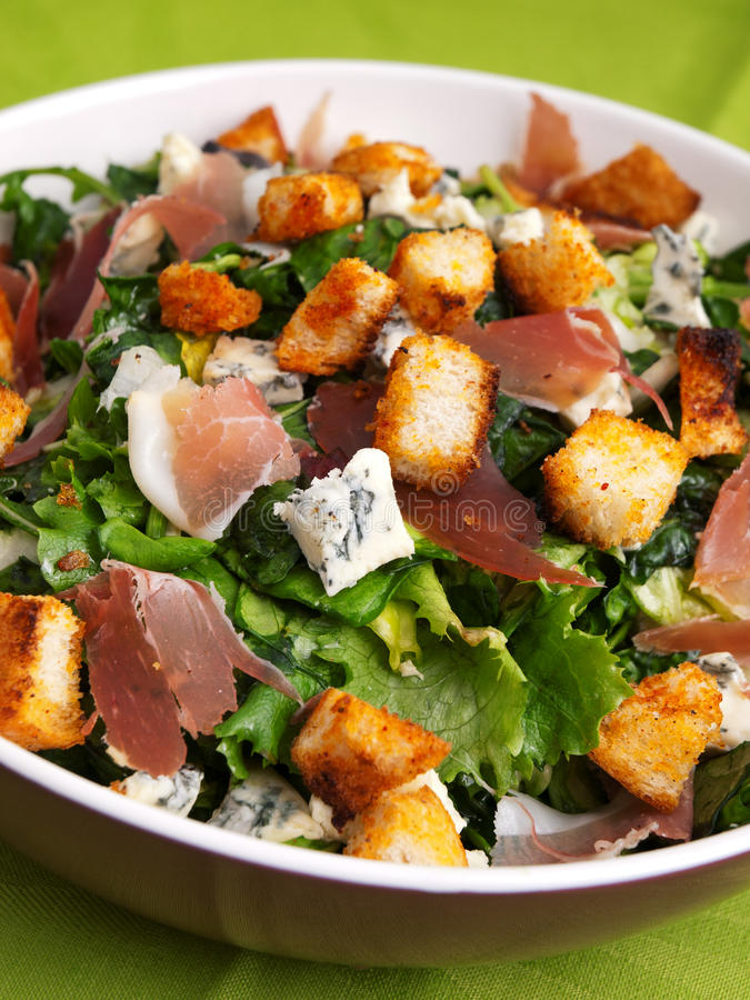 French Provencal Salad. With green salad, bacon, croutons and blue cheese. Close up stock image
